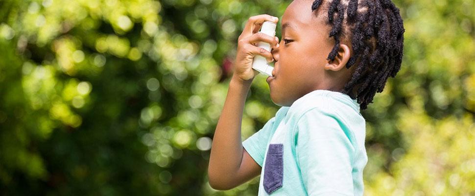 little girl using an inhaler