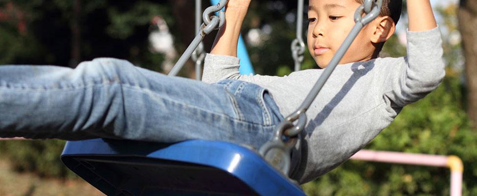 a little boy on a swing